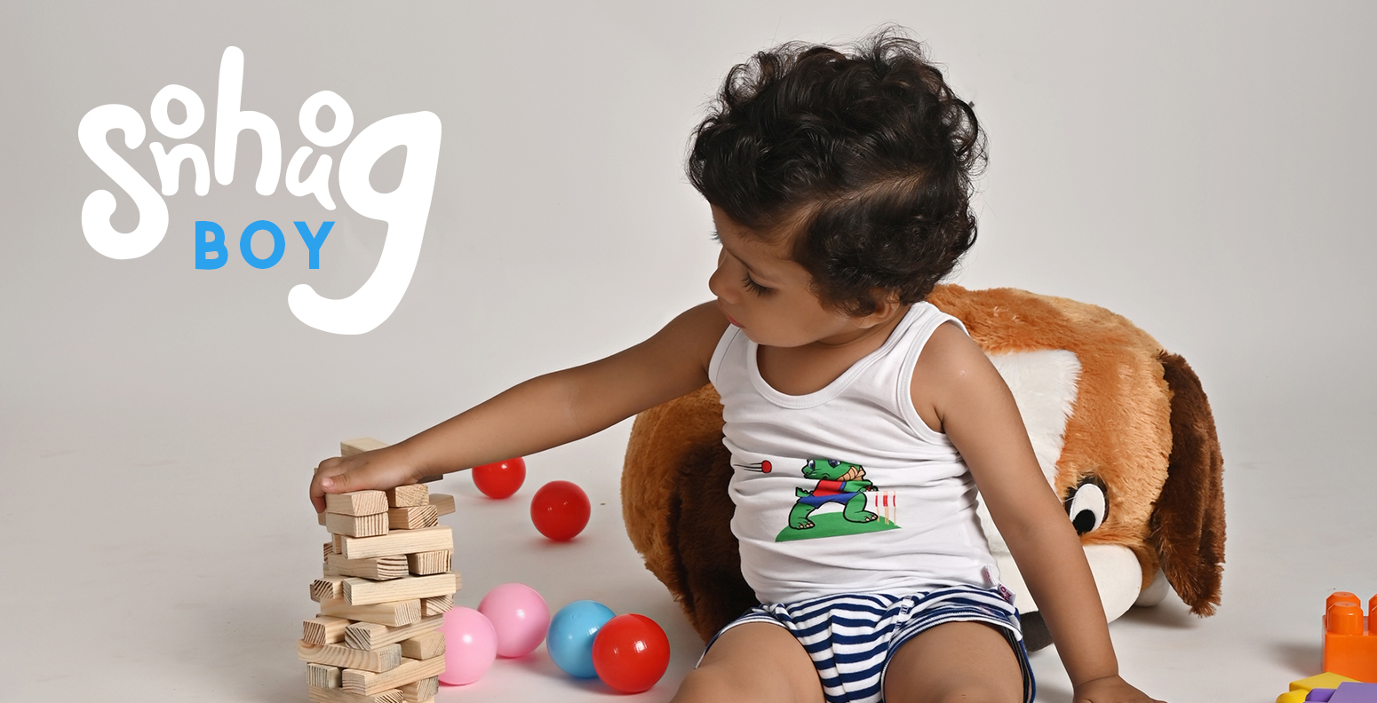 Cute Kid Sitting on Teddy Bear Wearing Baby Play Theme Vest and Sailor Briefs by Snhug with Toys Around.